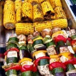 Summer BBQ - corn on the cob and vegetable skewers